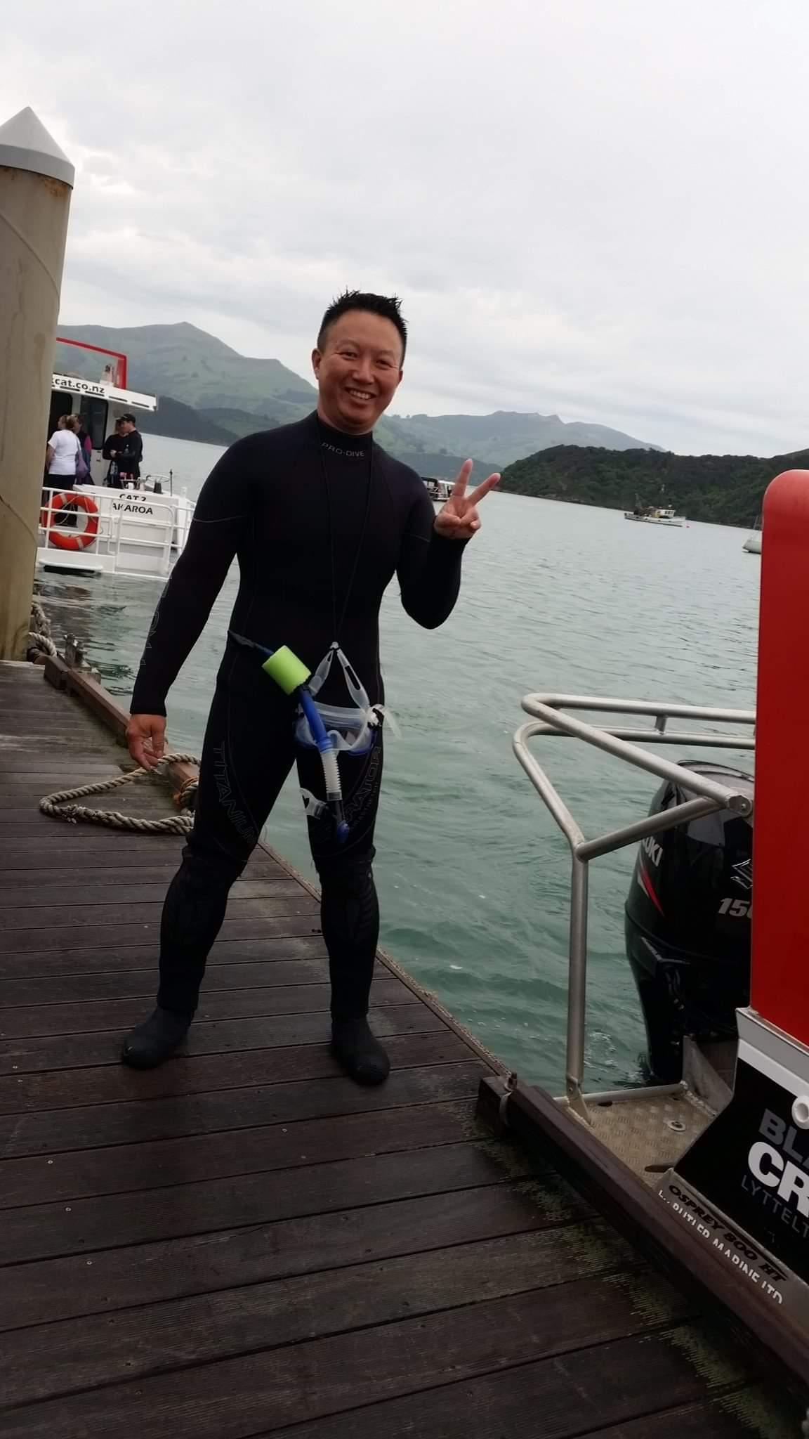 Akaroa chet wah swiming with dolphins .jpg